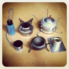 Very lightweight alcohol stoves.  All fit inside titanium mugs for a compact cook set, ideal for ultralight backpackers and compact survival/bug out kits.