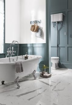 Teal blue walls in the bathroom. Ensure your period bathroom is eight on trend with a luxury freestanding bath from Burlington, now with up to 50% off in our Big Bathroom Brands Sale!