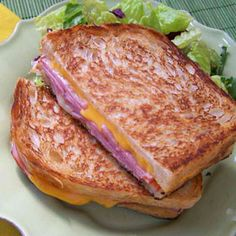 Who doesn't love a grilled cheese sandwich? Here in Los Angeles, there's an upscale food truck that only serves grilled cheese. This easy recipe has ham, just a little Dijon mustard, and two kinds of cheese.