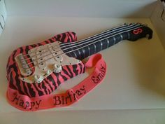 I made this pink and black zebra stripe guitar cake for a 9 year old girl's birthday...it was ALL edible and it was so much fun to do! kddeon
