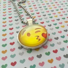 Our flirty Winking Kissy Face Emoji Necklace is a fun way to let someone know that you're smitten with them without saying a word!