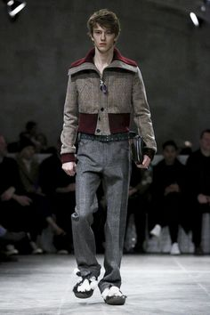 """On the runway hoodies,knickerbockers and corduroys were in abundance. Prada spelled it out for the crowd with its explanation of """"naive gestures"""" that punctuated the collection: p..."""