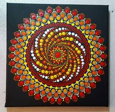The black background provides a stark contrast so that the mandala jumps out. Canvas size :20x20cm. Ready to hang on your wall or just a unique gift for anyone. A very whimsical painting for any age to appreciate. Dot Paintings started with Aboriginal origins and have found their