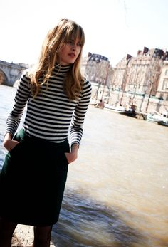 I have GOT  to try out this particular look- a) the striped blouse, turtle neck or not is your choice b) the skirt, perfect length c) black stockings