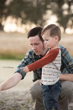 Father and son throwing rocks - Redding CA Newborn Photographer - Dani D Photography