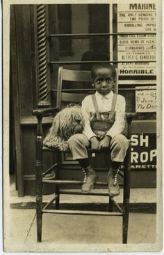 Boy in a chair with his dog.