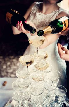 Toast yourselves with a Champagne tower. | 30 Swoon-Worthy Engagement Party Ideas