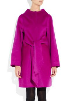 Excuse me if this makes me an unstylish slob, but does this look like a short Snuggie to anyone else?