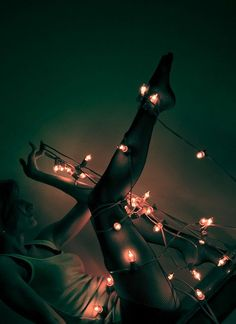 People wrapped in Christmas lights never fails... not.