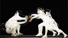 Multiple exposures were combined in camera to produce this image of Britta Heidemann of Germany and Shin A Lam of Republic of Korea in the women's Epee Individual Fencing semi-finals on Day 3 of the London 2012 Olympic Games at ExCeL