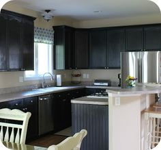 Thinking I may have to copycat this kitchen!  - My kitchen redo on the cheap... Builder grade cabinets painted black, added crown, and bead board.
