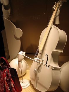 Hermes playing the cello, pinned by Ton van der Veer