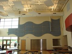 Tectum Finale Interior Wall Panels- The Finalé system consists of Tectum Interior Panels, Tectum spacer strips and SoniCor®* infill for spaces requiring a  Noise Reduction Coefficient (NRC) of .75 to 1.00.  Photo- Alpha Hart Lewis Elementary School, Columbia, MD