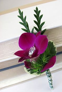 blinged out purple orchid boutonniere, for the guy stepping out in style with you