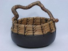 Black Clay bowl, with pine needle coil and drift wood handle: By Judy Ridgway