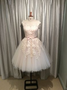 Be pretty in Pink in our House of Mooshki 'Poppy' dress in soft blush tulle and hand dyed lace.