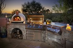 Pizza oven, 42 inch Twin Eagle barbecue, 3 drawer/door underneath, Tepanyaki grill with warming drawer below, Cooler drawer and a outdoor rated refrigerator.
