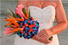 """Best Florida Beach Wedding Bouquet 2010""     Her bouquet was a beautiful tropical bouquet with Birds of Paradise, Pink Ginger, Tropical Amazon Roses, and Blue Dendrobium Orchids. It went perfectly with her romantic sunset wedding at Fort Desoto Beach near St. Pete Beach."