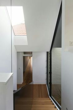 Unfurled House / Christopher Polly Architect - Interior view of the intermediary folded form and stair with glimpses of the original dwelling internally and externally