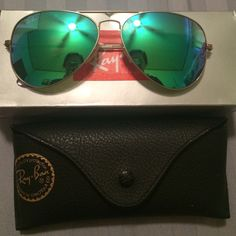 RAY BAN green/blue flash! Green/ blue flash raybans! Worn maybe 3-4 times, always kept in the case, wonderful condition! I just don't wear them enough. Comes with the box and cloth! Standard size 58-14. Ray-Ban Accessories Sunglasses