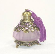 Decorative Purple Glass Jeweled Perfume Bottle with Tassels by Welforth Fine Pewter, http://www.amazon.com/dp/B0047I9BJ2/ref=cm_sw_r_pi_dp_XMh.qb1G20J69