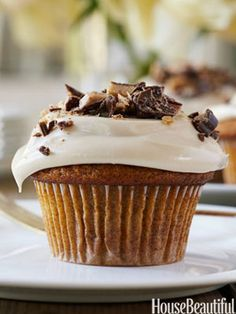pumpkin cupcake with maple frosting and chocolate on shavings on top
