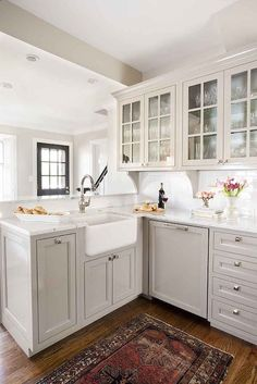 TerraCotta Properties: Gorgeous L shaped kitchen features gray shaker cabinets paired with marble countertops ...