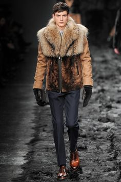 Fendi Men's RTW Fall 2014 - this collection is the ultimate example of the fur trend in menswear for Fall 2014. The collection was all about mixing organic textures (such as animal fur) with modern linear clothes. Fur was carried out as a theme through the whole collection even down to the fur covered runway!