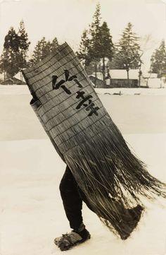 Man in a Traditional Minobashi Raincoat, Niigata Prefecture, 1956, by Hamaya Hiroshi (1915–1999)