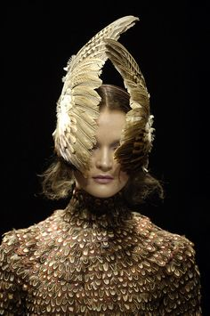 Very intricate design. Using everyday objects such as feathers to create something even more beautiful. De-construction/reconstruction. By Alexander McQueen