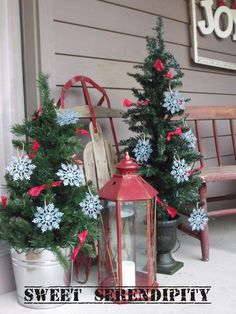 Trees in buckets and other elements - Big and bold Christmas porch decor.