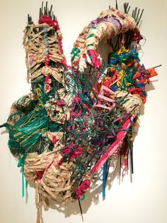 Artist: Judith Scott Age: Gender: female Media:mixed fiber  Date:within the years of 1978-2004 Explanation: wrapped fiber materials combined together to create a form. variety of materials are blended together to create the piece