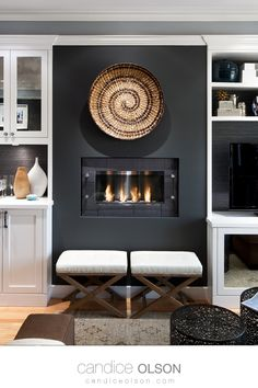 No venting in your home? No problem with a ventless Gel Fuel Fireplace! Design with Gray and White • White cabinetry in the family room • Wallpaper backed open shelves • #candiceolson #candiceolsondesign Interior Exterior, Interior Walls, Home Interior Design, Tabletop Fire Bowl, Candice Olson, Living Spaces, Living Room, Elements Of Design, Room Wallpaper