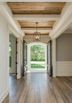 How perfect is this entryway. From the doors to the ceiling to the wood to the paint. Everything, perfect.