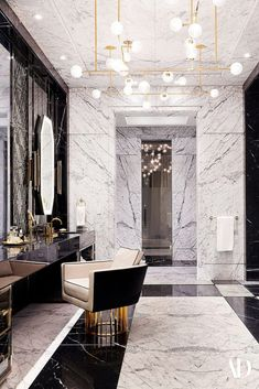 The centerpiece of the master bath is a 4,000-pound tub of faceted black marble carved from a single block. #marble #light #vanity #chandelier #chair #mirror #towel #luxury #bath #bathroom Top Interior Designers, Home Interior Design, Interior Decorating, Best Interior, Luxury Interior, Cute Desktop Wallpaper, Amazing Bathrooms, Dream Bathrooms, Beautiful Interiors