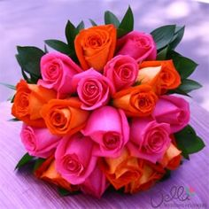 Bright pink and orange rose bouquet.  Tropical and simple at the same time.  @Erin Duncan Wedding Flowers