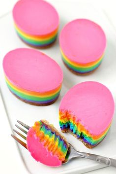 Rainbow Cheesecake Easter Eggs. Egg-shaped cheesecakes with layers of rainbow colors. Your Easter meal won't be complete without these multi-colored beauties!