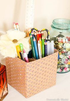 A step above the average pencil cup, this cute caddy boasts special compartments (read: repurposed toilet paper rolls) to organize home office essentials. Get the tutorial at Domestically Blissful »