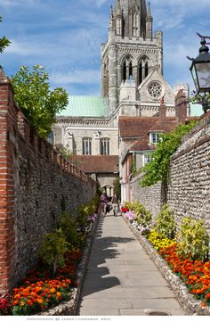 England.  Chichester, West Sussex.   St. Richard's Walk.   Photograph by James I. Chrismas, via 500 px.   St. Richard's Walk leads from Chichester Cathedral's Cloisters to The Deanary.  For the majority of the year it is bursting with flowers.