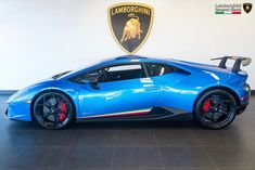 Lamborghini Huracan Performante painted in Blu Nethuns w/ Tricolore stripes along the doors   Photo taken by: @lambonewportbeach on Instagram