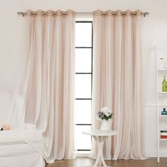 Lend a touch of elegance to your master suite or guest room with this lovely curtain, featuring a light-blocking design with sheer lace overlay. ...