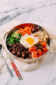 This Beef Bibimbap recipe puts a Korean classic within the grasp of any home cook. Our Beef bibimbap recipe takes about 45 minutes from start to finish. Bibimbap Recipe, Bibimbap Bowl, Korean Bibimbap, Korean Beef, Korean Food, Chinese Food, Cooked Carrots, Asian Recipes, Chickpeas