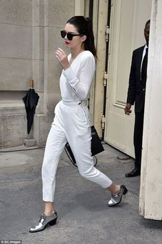 White on trend: Kendall Jenner appeared to want to prolong her role as a Chanel bride as s...