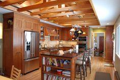 Sensational Vaulted Ceiling decorating ideas for Elegant Kitchen Traditional design ideas with bookshelf exposed beams hanging pot rack metal stools pendant lights split level