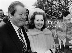 24th February 1981: The 8th Earl Spencer (1924 - 1992) with his wife Raine, formerly Lady Lewisham, and his son Charles, Viscount Althorp on a visit to Buckingham Palace.