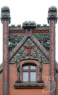 Branches and leaves carved into tower  Katowice, Poland