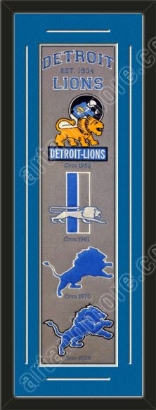 This framed Detroit Lions heritage banner, double matted in team colors to 12 x 36 inches.  The lines show the bottom mat color.  $139.99 @ ArtandMore.com