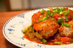 Meatballs over sauce and Green beans