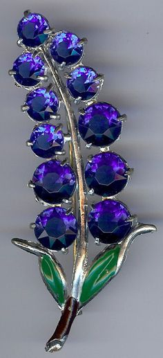 VINTAGE GREEN ENAMEL FACETED PURPLE & BLUE RHINESTONE PIN