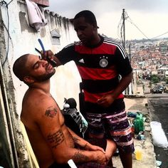 Adriano the former Brazil star gets a shave